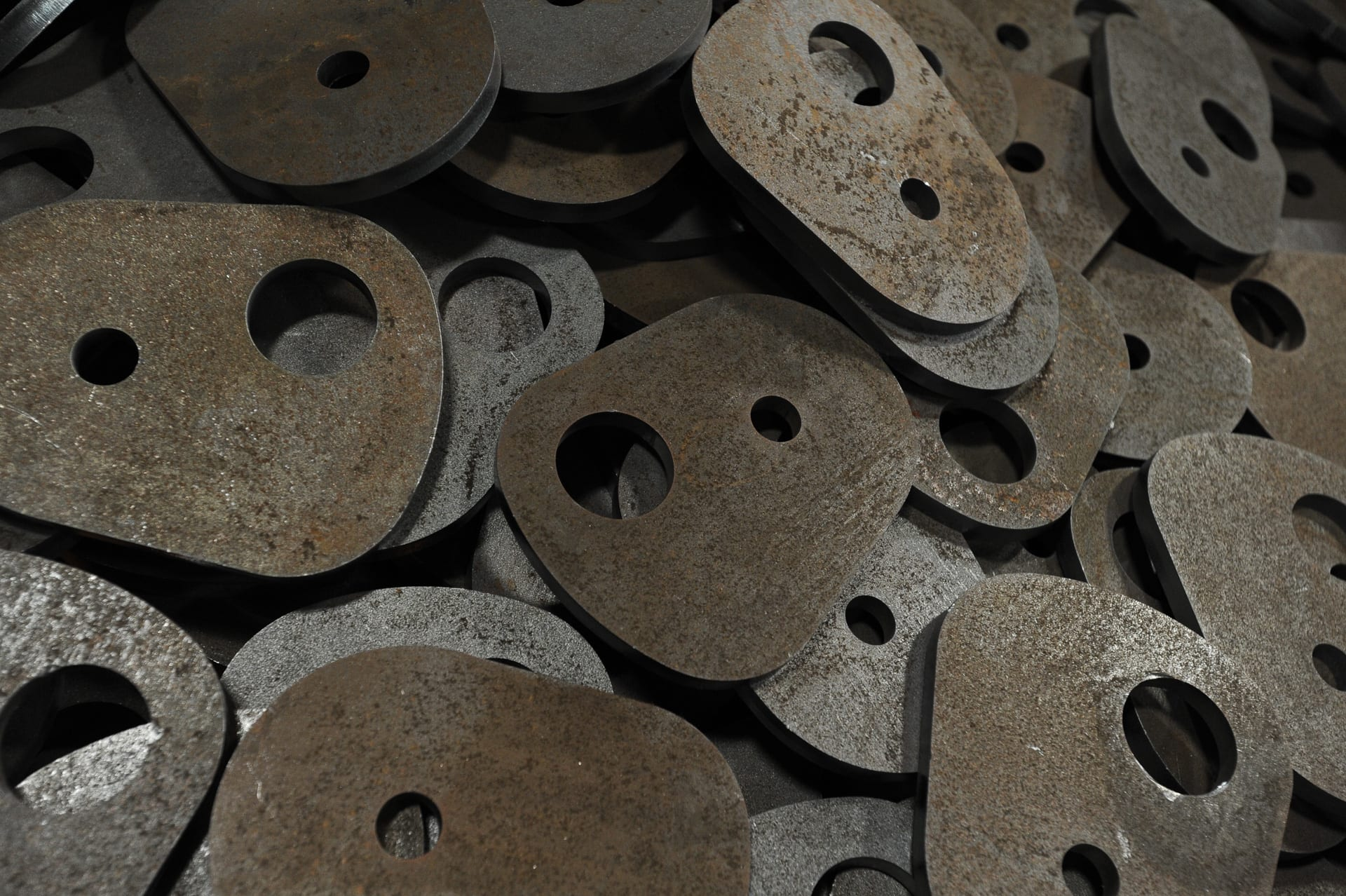 Cut and Machine Punched Metal Pieces
