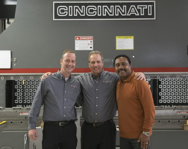 Manufacturing Executives in front of Cincinnati CNC machine